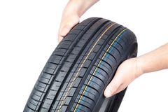 Free Car Tire In The Hands On White Background. Royalty Free Stock Images - 58469039