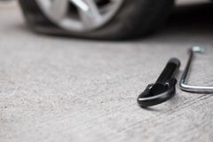 Car tire leak because of nail pounding. flat tyre on road. Flatt. En punctured auto wheel Royalty Free Stock Images