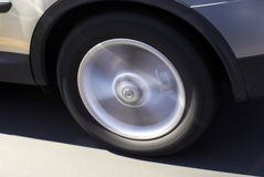 Car tire in motion stock photo