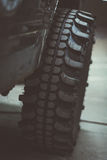 Car tire for off-road use. Angle view Stock Images