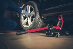 Car Tire Replacement Service. Auto Service. Car Tire Replacement and Maintenance stock images