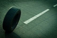 Car tire on the road Stock Images