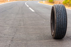 Car tire on the road Stock Photo