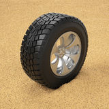 Car tire in the sand. Winter tires Stock Photos