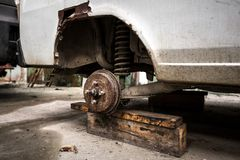 Car without tire Royalty Free Stock Photos