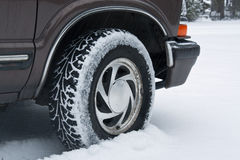 Car Tire in Snow. A car tire patterned with fresh snow royalty free stock photo