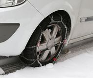 Car tire with snow chains in winter Stock Image