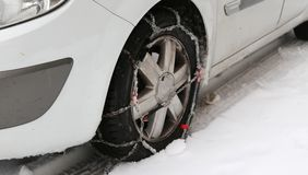Car tire with snow chains in winter cold Stock Images