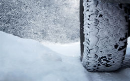 Car tire in the snow. Close up of car tire in the snow with copy space Stock Photos
