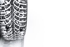 The car tire in the snow close up. Car tracks on the snow. Traces of the car in the snow. Winter tires. Tyres covered with snow at. Winter road stock photo