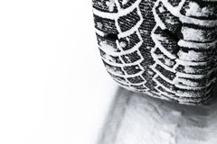 The car tire in the snow close up. Car tracks on the snow. Traces of the car in the snow. Winter tires. Tyres covered with snow at. Winter road royalty free stock photos