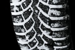 The car tire in the snow close up. Car tracks on the snow. Traces of the car in the snow. Winter tires. Tyres covered with snow at. Winter road. Isolated on royalty free stock photos