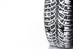 The car tire in the snow close up. Car tracks on the snow. Traces of the car in the snow. Winter tires. Tyres covered with snow at. Winter road. Winter road royalty free stock photos
