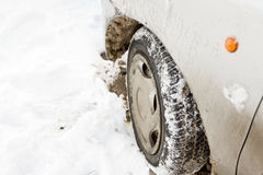 Car tire in the snow drift Stock Photography