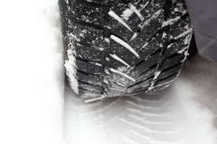 Car tire in the snow Royalty Free Stock Image
