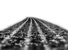 Car tire track on asphalt royalty free stock photo