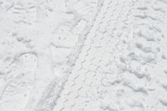 Car tire track in snow Royalty Free Stock Photos