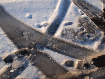 Car tire track in snow Stock Images
