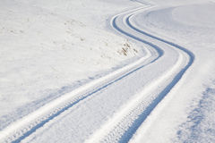 Car tire track on winter road Royalty Free Stock Photography