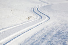 Car tire track on winter road Stock Images