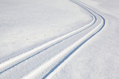 Car tire track on winter road Royalty Free Stock Photo