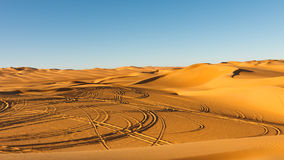 Car Tire Tracks in the Desert Royalty Free Stock Images