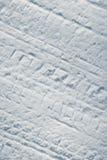 Car tire tracks in snow Stock Photos
