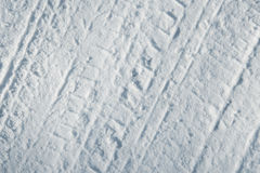 Car tire tracks in snow Royalty Free Stock Photography
