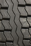 Car tire tread. Close up of automotive rubber tire tread abstract pattern Stock Images