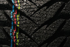 Car tire and water drops Stock Photos