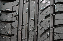 Car tire with with water drops to background Stock Photos