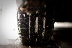 Car Tire Winter Close Up. Rear wheel car tire in the winter season with snow on it Royalty Free Stock Photo