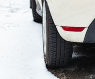 Car tire in winter on the road. Car tire in winter on the road covered in snow stock photography