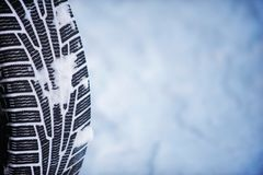 Car tire in winter on the road covered with snow Royalty Free Stock Photography
