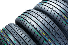 Car tires. A closeup image of unused summer car tires stock photo