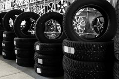 Car tires and alloy wheels in automobile   center. Car tires and alloy wheels in automobile service center Stock Photo