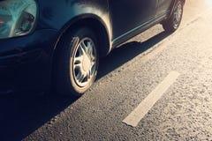 Car tires on asphalt road Stock Photo