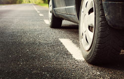 Car tires on asphalt road. With a dividing line Royalty Free Stock Image