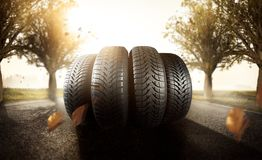 Car tires on a autumn road. Car tires on a road winter snow transport royalty free stock photo