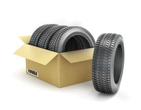 Car tires in a box. Isolated on a white background Stock Image