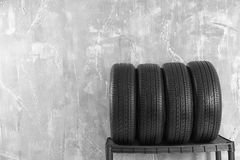 Car tires on. Grey background royalty free stock photo