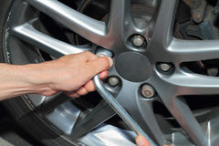 Car tires changing close up Stock Photos