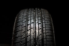 Car tires. Close-up on black background Royalty Free Stock Images