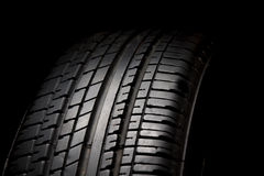 Car tires. Close-up on black background Royalty Free Stock Photos