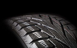 Car tires close-up. Wheel profile structure on black background Royalty Free Stock Photography