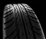 Car tires close-up Winter wheel profile structure on black background - 3d rendering Stock Photography
