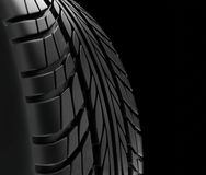 Car tires close-up Winter wheel profile structure on black background - 3d rendering Royalty Free Stock Images