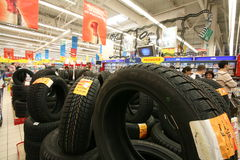 Car tires in a commercial center Stock Photo