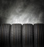 Car tires on a dark background. stock photo