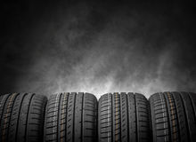 Car tires on a dark background. Royalty Free Stock Photography